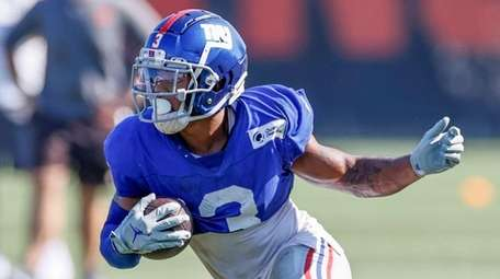 Giants wide receiver Sterling Shepard runs after a
