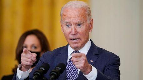 President Joe Biden answers questions from members of