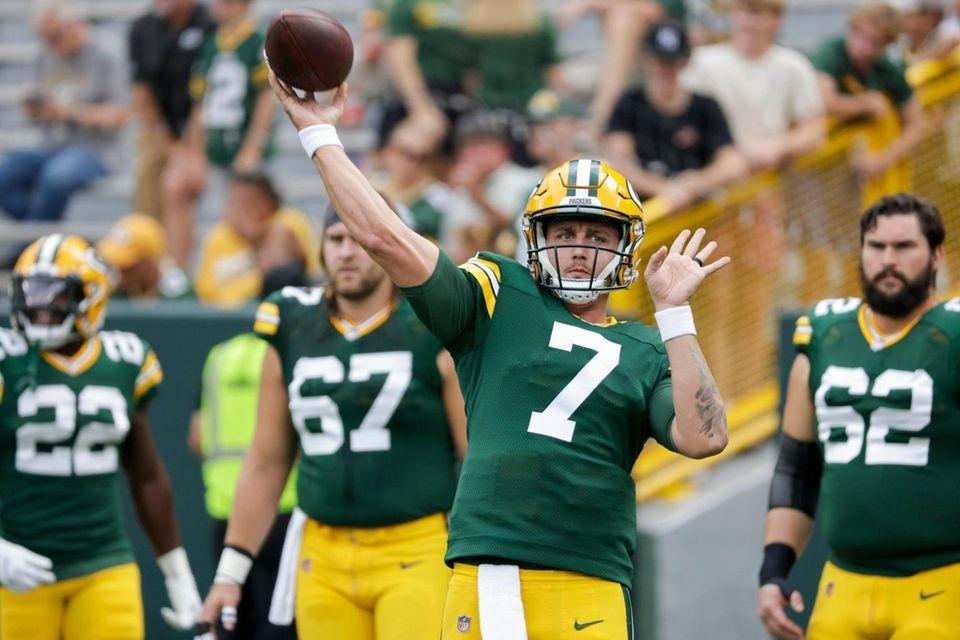 Green Bay Packers' Kurt Benkert warms up before