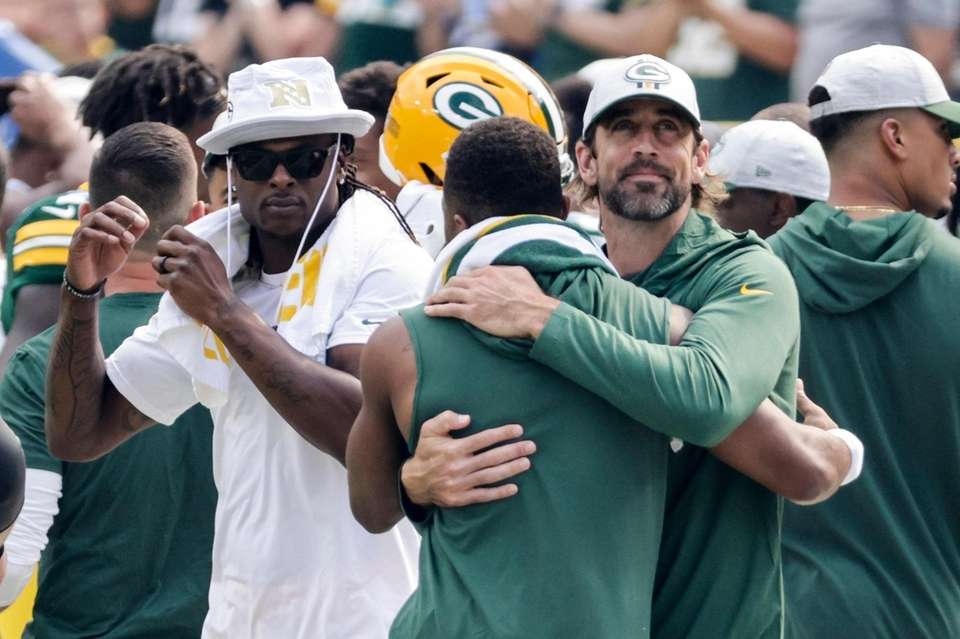 Green Bay Packers' Aaron Rodgers hugs Randall Cobb