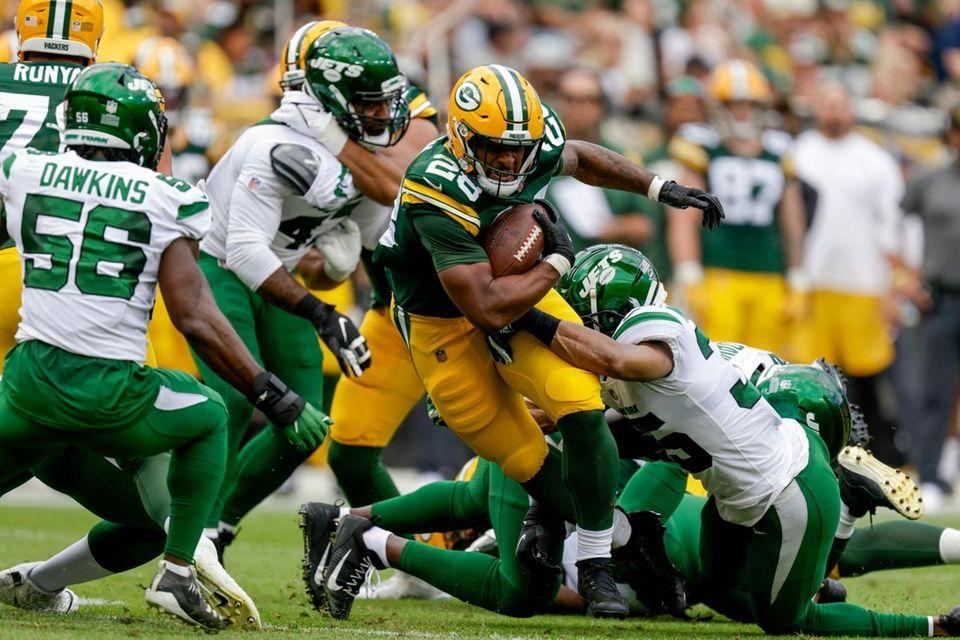 Green Bay Packers' AJ Dillon runs during the