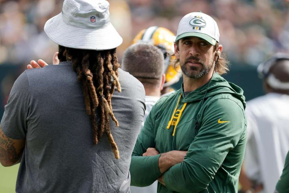 Green Bay Packers' Aaron Rodgers watches from the