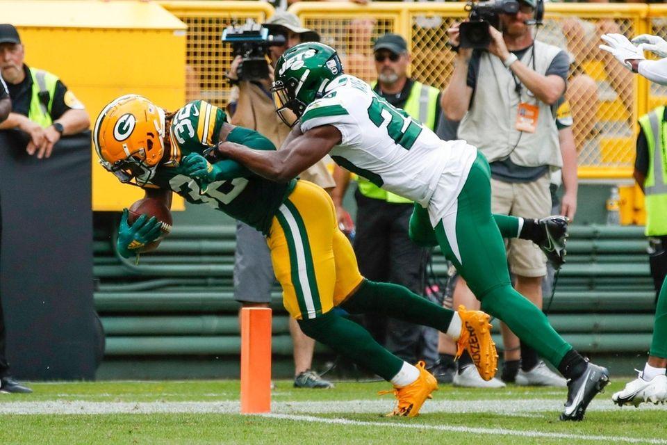 Green Bay Packers' Kylin Hill runs past New