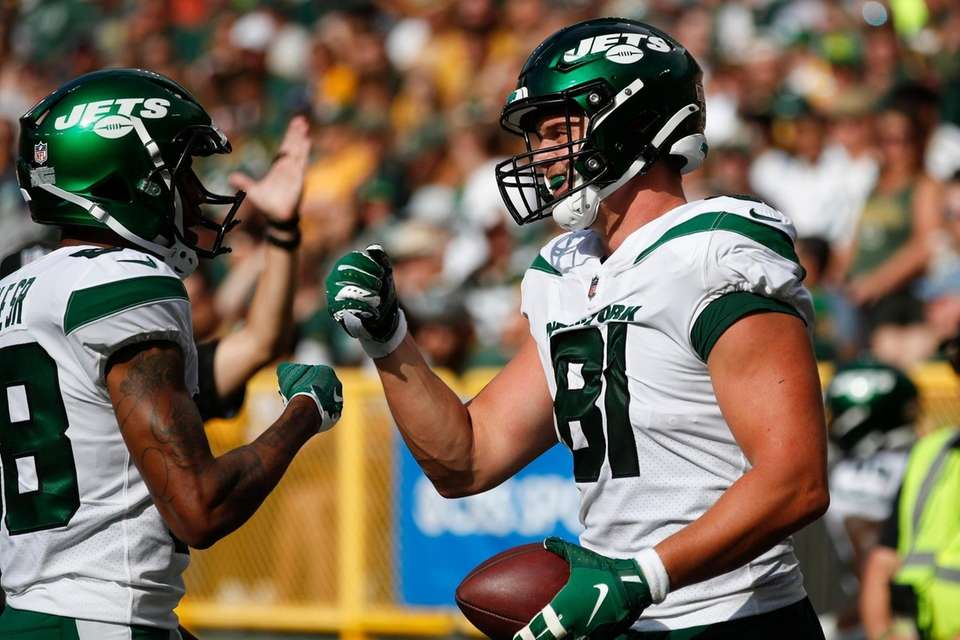 New York Jets' Tyler Kroft is congratulated by