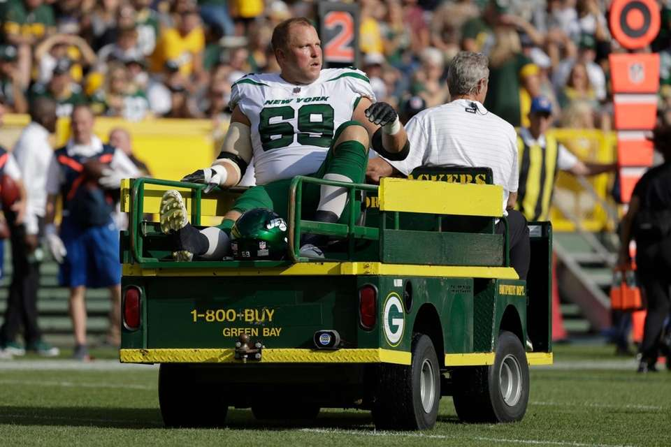 New York Jets' Conor McDermott is taken off