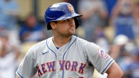 The Mets' J.D. Davis reacts at the plate