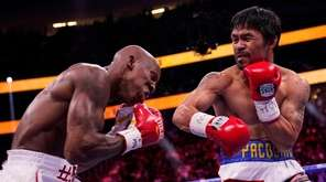 Manny Pacquiao, right, of the Philippines, hits Yordenis