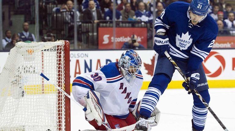 Henrik Lundqvist gets scored on as Toronto Maple