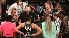 Liberty head coach Walt Hopkins directs his players