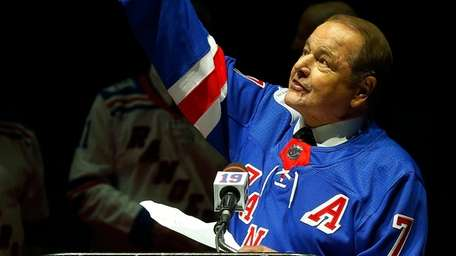 Rod Gilbert speaks during the jersey retirement ceremony