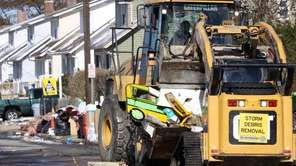 A Nassau County Storm Debris Removal team works