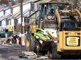 A Nassau County Storm Debris Removal team works