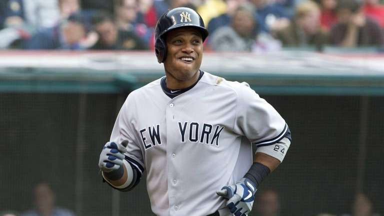 Robinson Cano smiles after hitting a solo home
