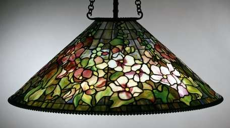 A Hollyhock Hanging lamp on display at the