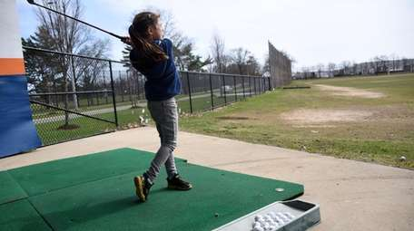 Pratice your golf swing at the driving range
