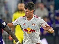 Orlando City forward Daryl Dike (18) controls the