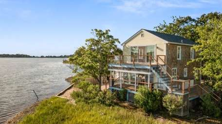This two-bedroom waterfront home in Southold is listed