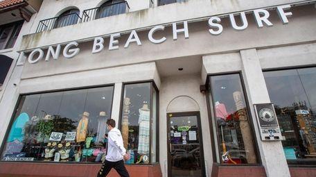Browse the shelves at Long Beach Surf shop.