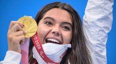Anastasia Pagonis of the U.S. displays her gold