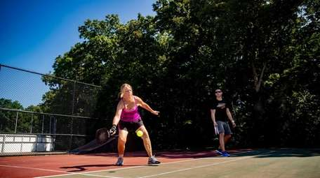 Cathy Sciacca of Smithtown and Jason Leite play