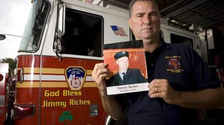 Former FDNY Deputy Chief Jim Riches stands in