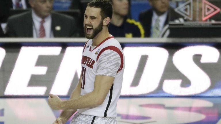 Louisville guard/forward Luke Hancock reacts after defeating Michigan.
