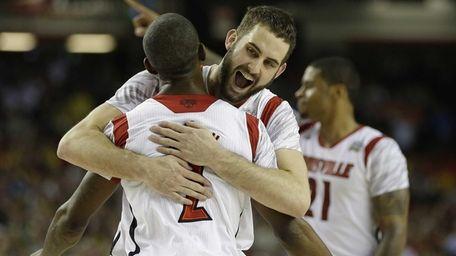 Louisville guard/forward Luke Hancock (11) embraces Louisville guard