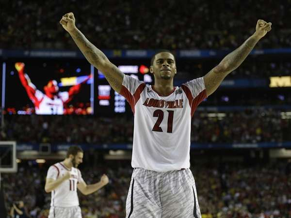 Louisville forward Chane Behanan reacts after defeating Michigan