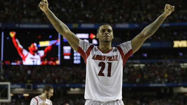Louisville forward Chane Behanan reacts after defeating Michigan