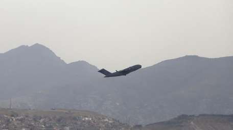 A U.S. military aircraft leaves the airport in