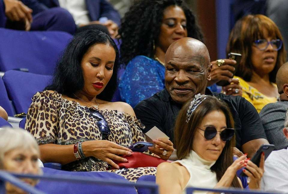 Mike Tyson attends the match between Naomi Osaka