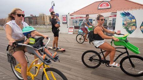 Bicycle riders along the beardwalk in Long Beach