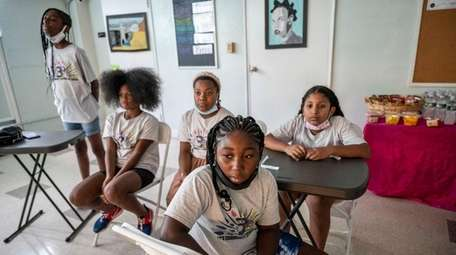 Young videographers watch Tuesday as videos they created