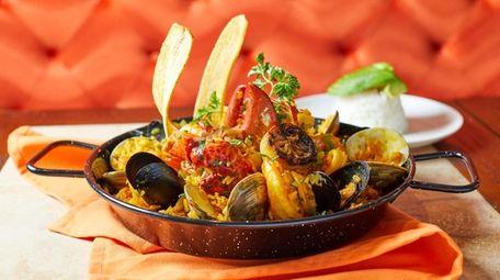 Paella with saffron rice, clams, mussels, calamari, bay