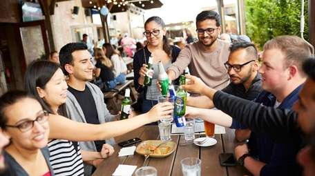 Guests enjoy bites and drinks at Garden Social