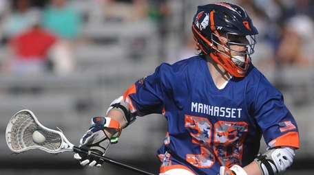 Michael Farrell playing lacrosse for Manhasset High School