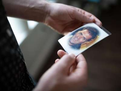 Tim Kelly holds a photo of his father,