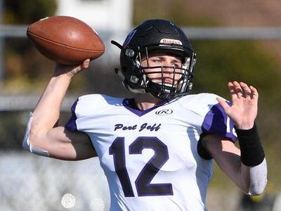 Port Jefferson's Luke Filippi passes the football against