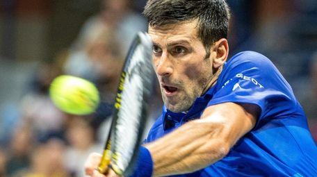 Novak Djokovic of Serbia hitting a backhand against