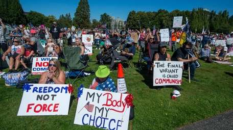 Anti-vaxxers protest Gov. Jay Inslee's vaccine mandate for