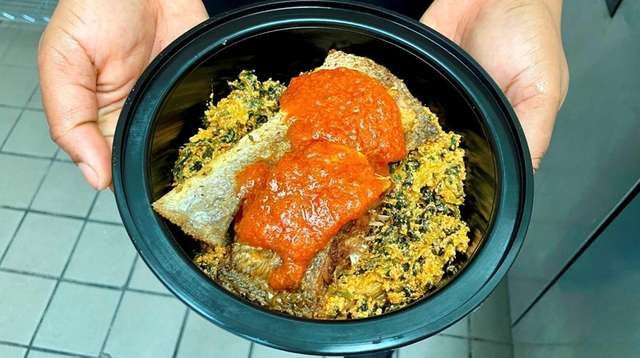 Egusi (melon-seed soup) is served with fish at