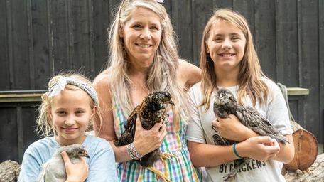 Amanda Krzenski and her daughters, Cameron, 10, left,