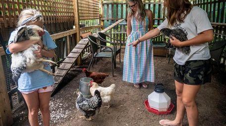 Amanda Krzenski and her daughters Cameron, 10, left,