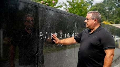 Retired NYPD Officer Glenn Tarquinio visits a 9/11