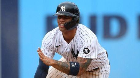 The Yankees' Gleyber Torres gestures after he steals