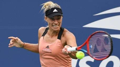 Angelique Kerber returns to Sloane Stephens during the