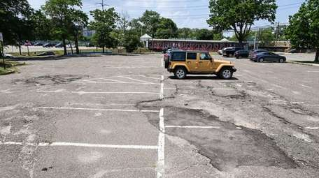 The rough surface of the south parking lot