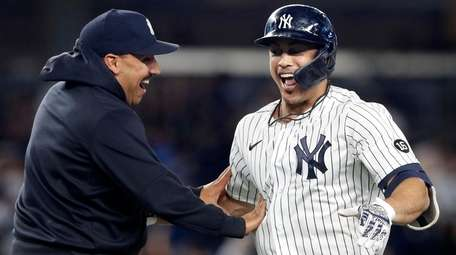 Giancarlo Stanton of the Yankees celebrates his 11th-inning