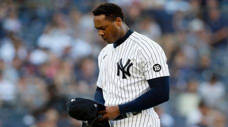 Aroldis Chapman of the Yankees walks to the