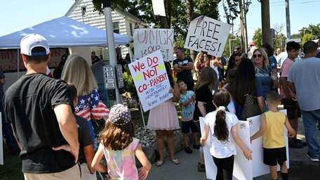 Parents and protesters gathered in Smithtown on Saturday,